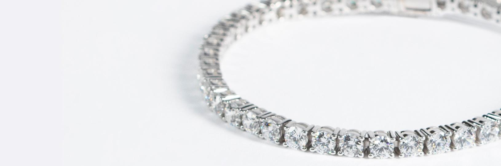 A tennis bracelet featuring several round cut diamonds