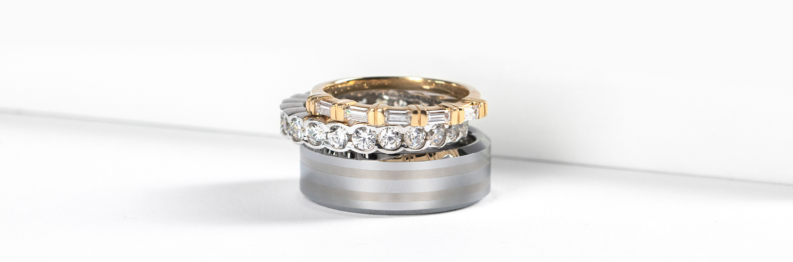 Three wedding bands stacked side by side