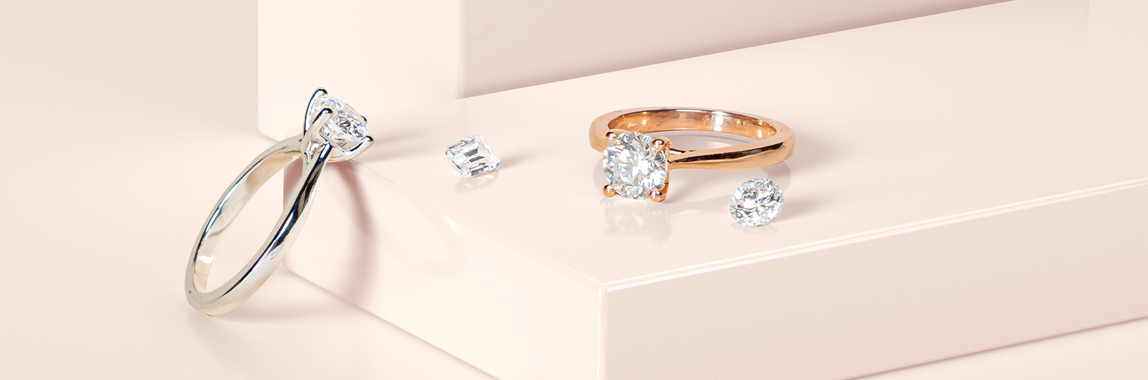 Two engagement rings featuring lab grown diamonds
