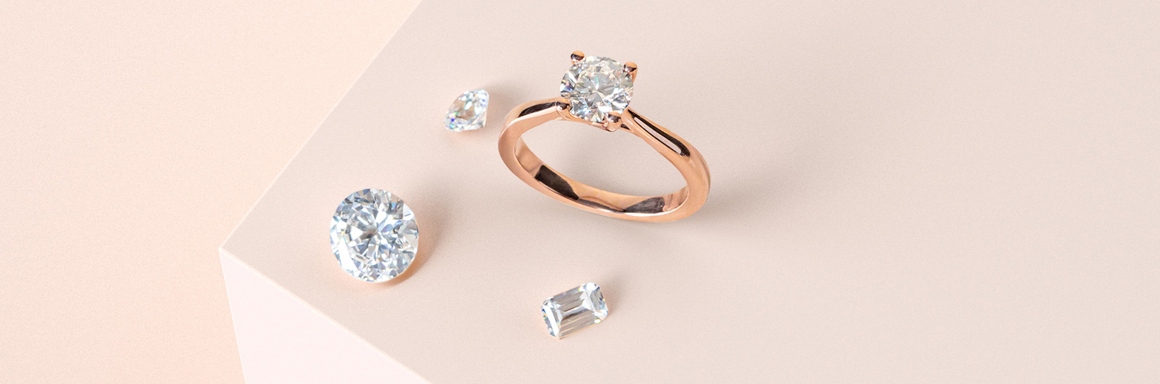 A round cut lab grown diamond in a rose gold setting