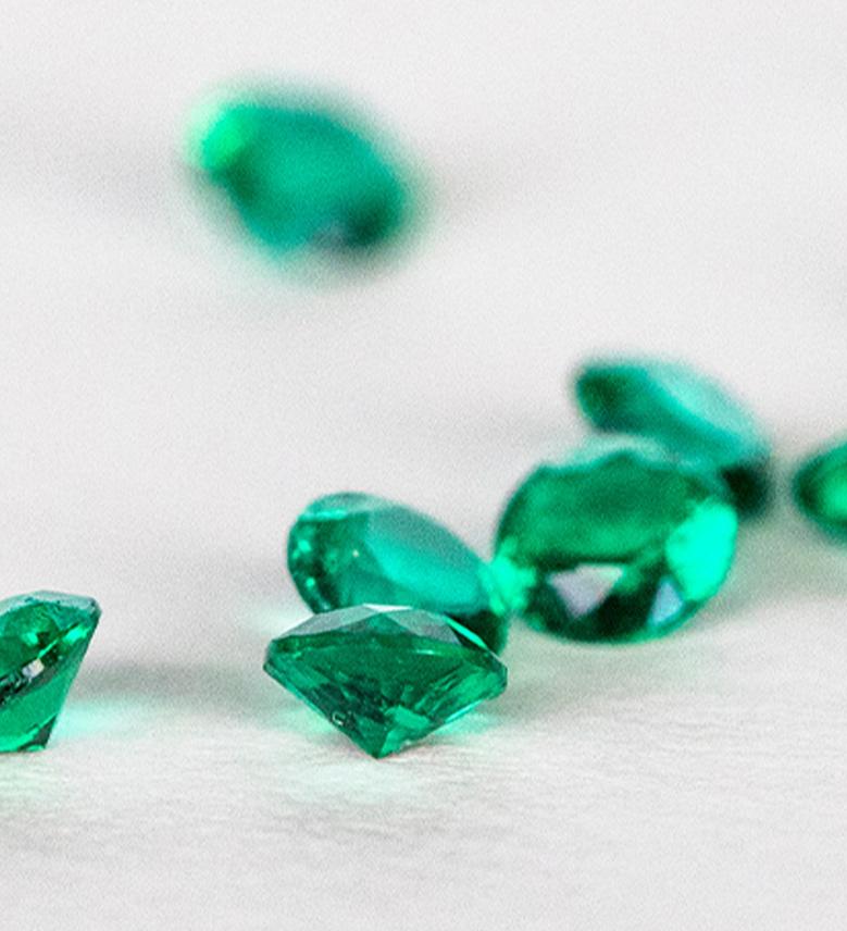 Several round cut emerald stones
