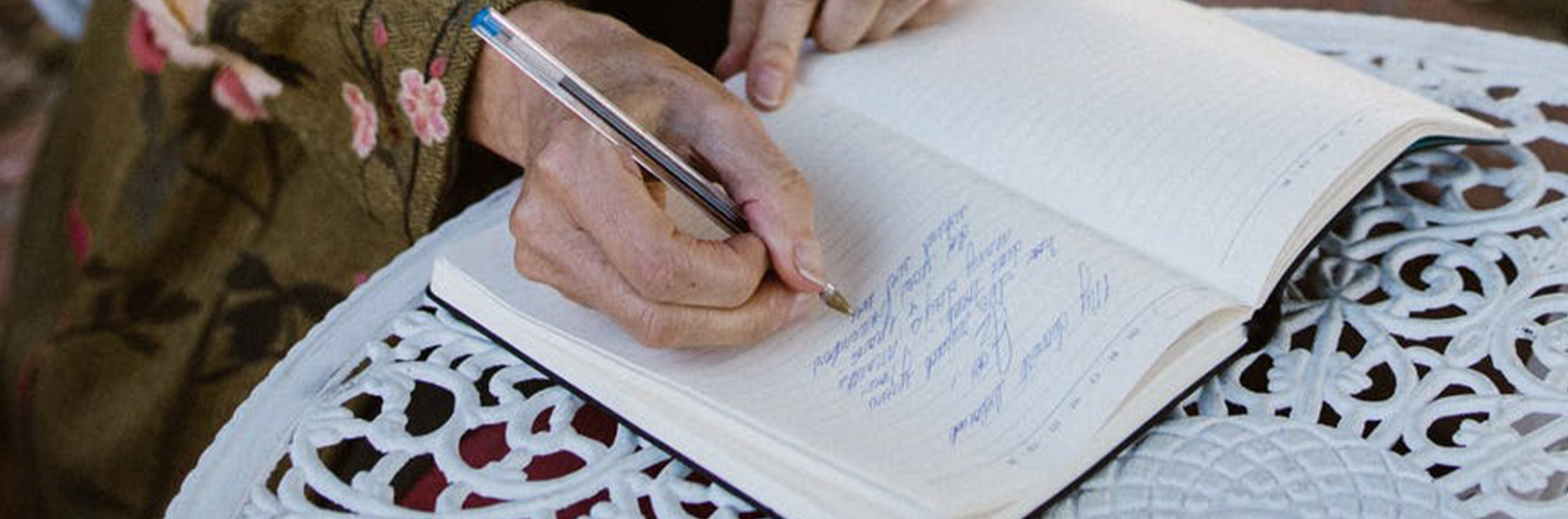 Image of a person writing their wedding vows