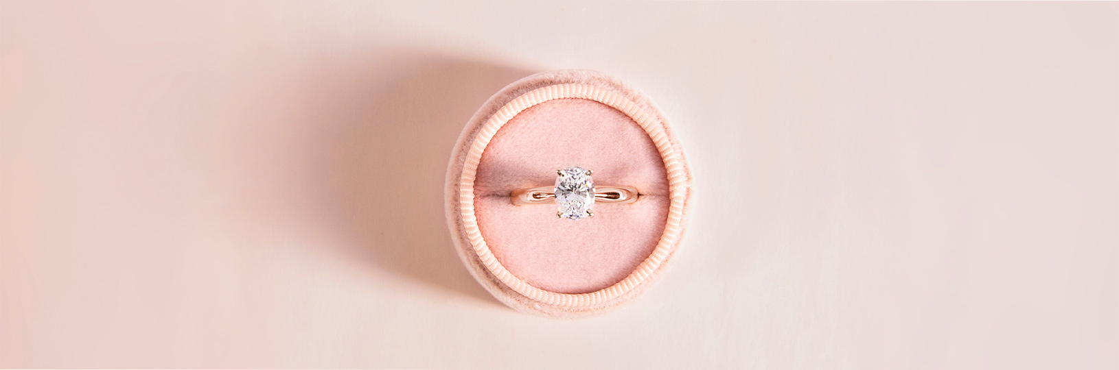 An oval cut solitaire engagement ring featuring a lab grown diamond