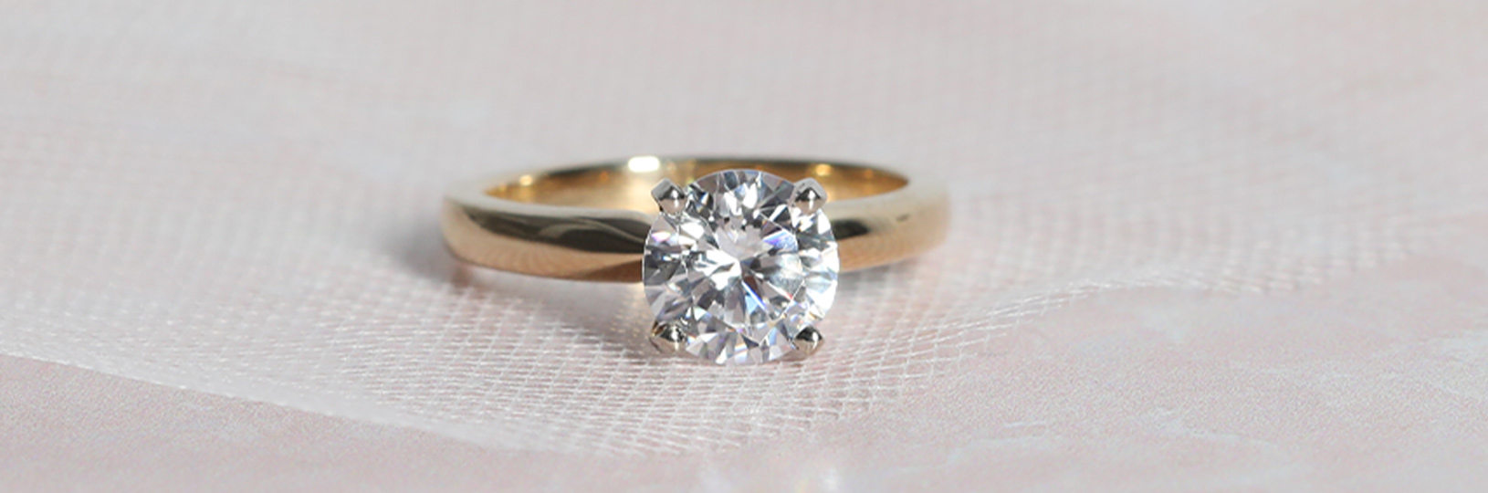 A round cut solitaire engagement ring featuring a lab grown diamond