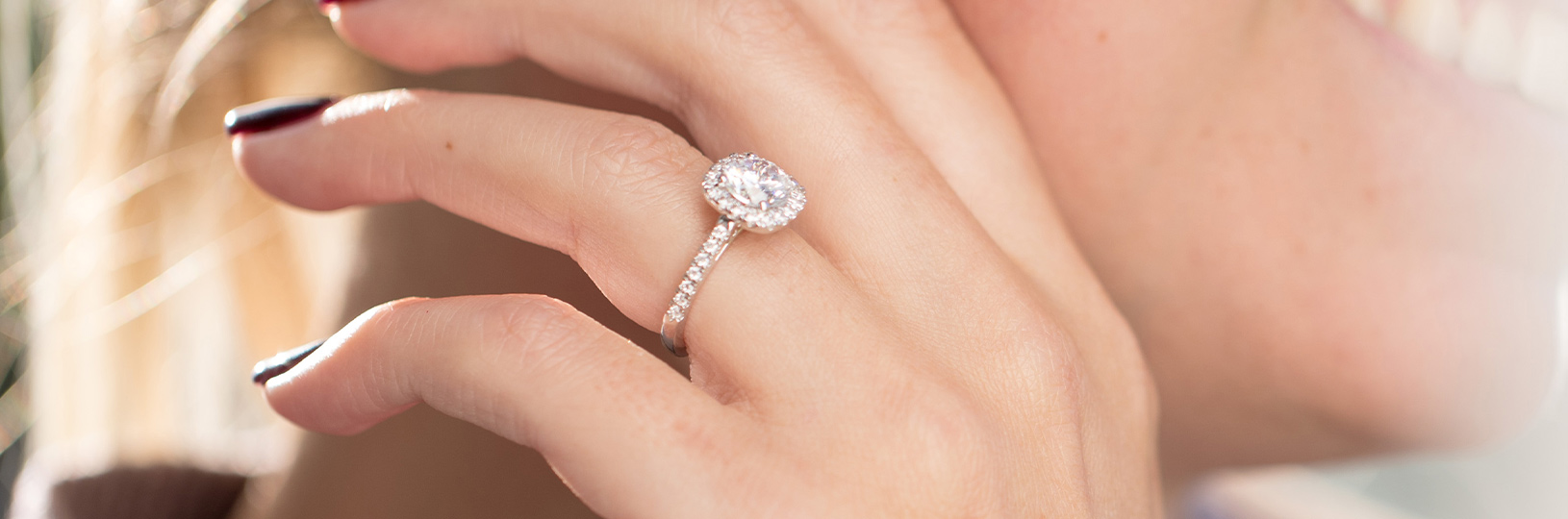 A white gold engagement ring in a halo setting