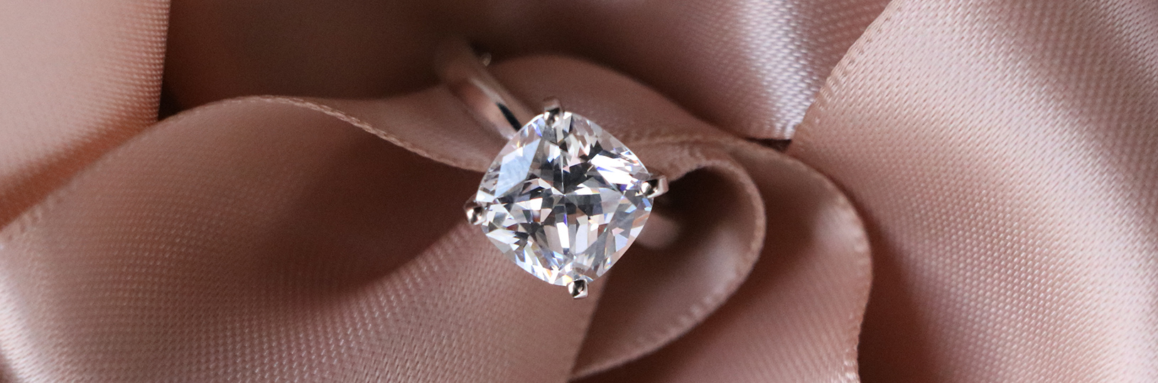 Cushion cut lab created diamond engagement ring.