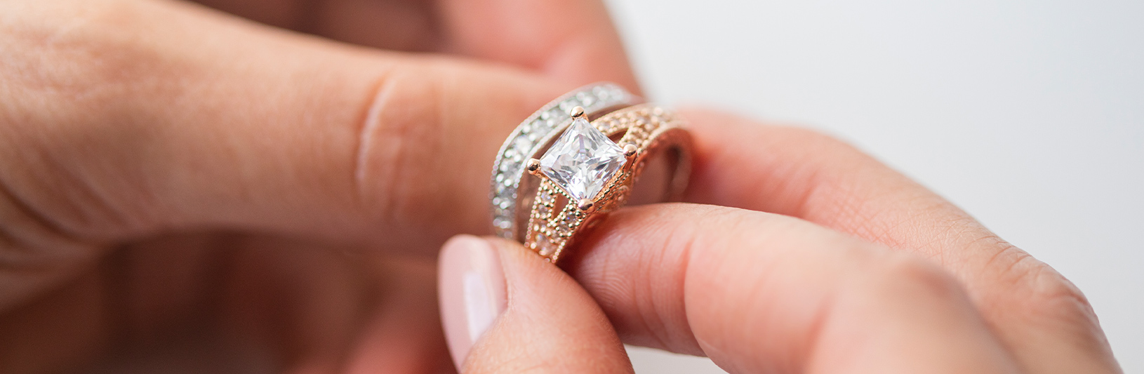 A Princess cut engagement ring paired with a silver accented wedding band