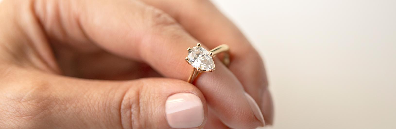 A pear cut lab grown diamond in a claw setting